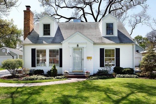White home in suburbs with brick sidewalk : Stock Photo