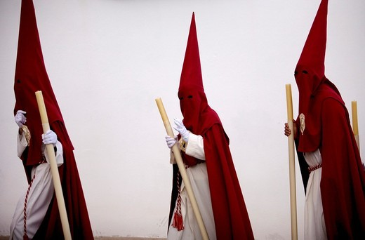 Penitents walk in a street during Easter Holy Week celebrations in Espera village, Cadiz province, Andalusia, Spain. : Stock Photo