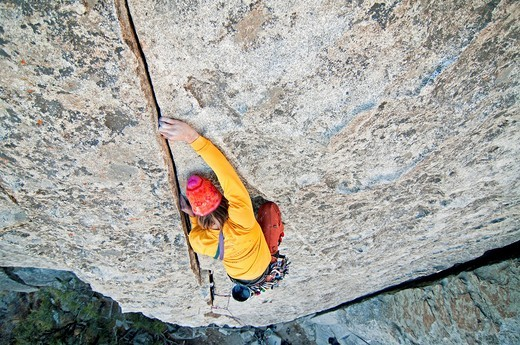 Nic Houser rock climbing a route called Bloody Fingers which is rated 5,10 and located on Super Hits Wall at the City Of Rocks National Reserve near the town of Almo in southern Idaho : Stock Photo