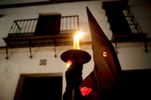 A penitent participates in a Holy Week procession in the town of Prado del Rey in southern Spain´s Cadiz Sierra region in Andalucia. Easter processions in Andalucia during Holy Week are a public display of Catholic imagery which tells the story of Jesus C : Stock Photo