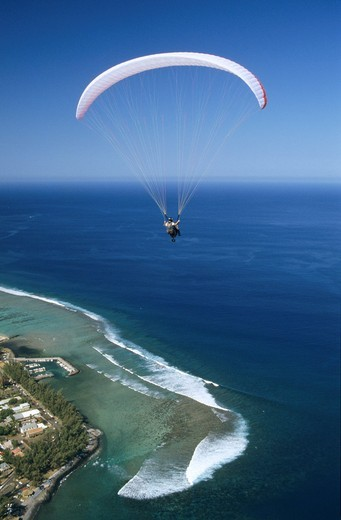 Aerial view of paraglider over Saint Leu town and lagoon, Reunion Island France, Indian Ocean : Stock Photo