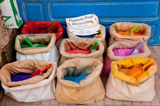Closeup of colorful bags of pigments and dyes for sale in the souqs of Essaouira, Morocco : Stock Photo