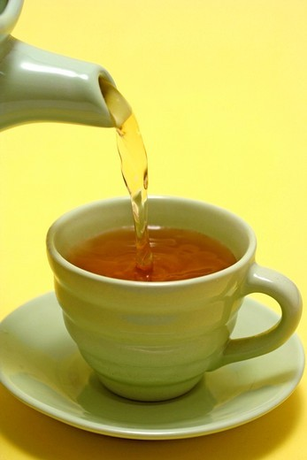 Pouring tea : Stock Photo