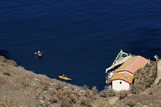 Two kayakers in the landing cove of Santa Barbara Island : Stock Photo