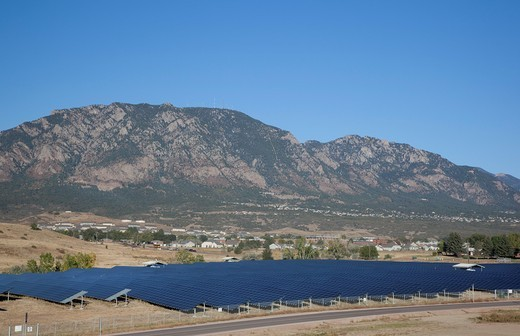 Stock Photo: 1566-578983 Colorado Springs, Colorado - A solar photovoltaic facility uses contaminated land to generate renewable energy  The solar farm was built on top of a former landfill at the U S  Army´s Fort Carson  It generates 3,200 megawatt-hours of power every year  In