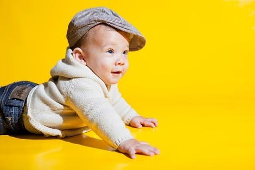 Stock Photo: 1566-579772 Studio shot of Caucasian baby wearing hat