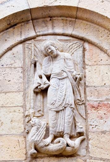 Segovia, Segovia Province, Spain  Statue on facade of Iglesia de San Miguel of Saint Michael wounding a dragon : Stock Photo