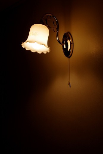 Light mounted on wall in dark room : Stock Photo