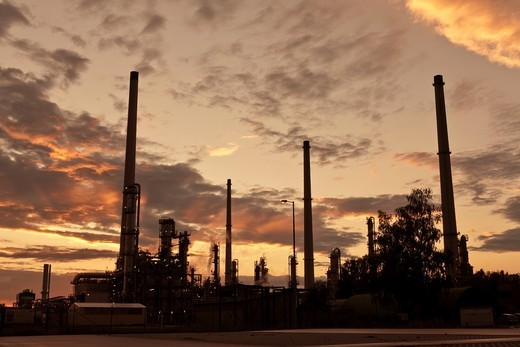 Sunset over an oil refinery in germany. : Stock Photo