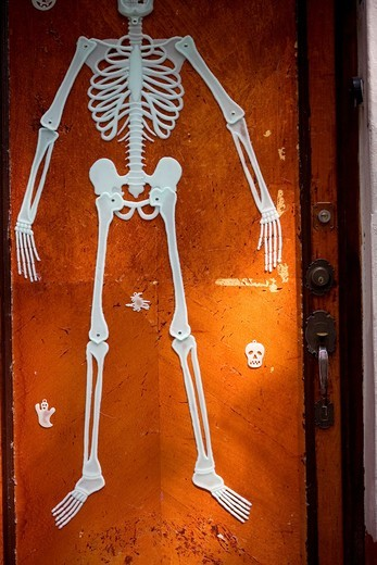 Stock Photo: 1566-582675 A skeleton decorates a home´s door in Coyoacan ahead of Day of the Dead celebrations, Mexico City.
