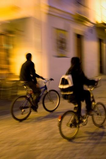 Cyclists in calle Consistorio Jerez de la Frontera  Cádiz province  Spain : Stock Photo