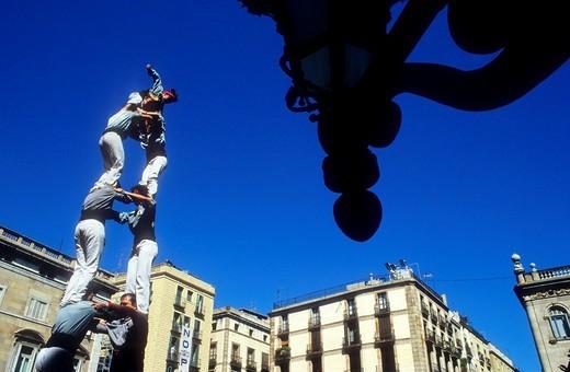 Stock Photo: 1566-583797 Castellers de Sants ´Castellers´ building human tower, a Catalan tradition Festa de la Merçe, city festival  Plaça de Sant Jaume Barcelona,Catalonia, Spain