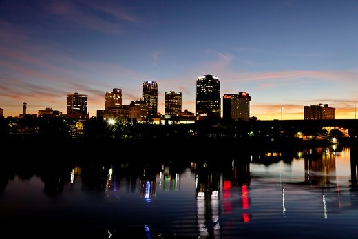 The Arkansas river and the city skyline of Little Rock Arkansas at dusk : Stock Photo
