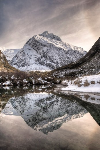 Stock Photo: 1566-585631 Mt Talbot, winter reflection with ice halo in sky, Hollyford valley, Fiordland National Park, World Heritage site
