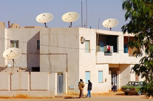 Stock Photo: 1566-585844 Modern residential buildings with satellite dishes on the roof in the town of Jerma, Libya