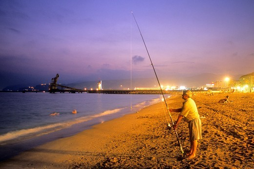 Stock Photo: 1566-588402 Fisherman in 'Ciudad Luminosa' beach Almeria  Andalucia, Spain
