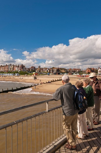People standing on the pier viewing the beach in Southwold , Suffolk , England , Britain , Uk : Stock Photo