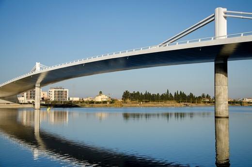 Sant Jaume d´Enveja new bridge ´Lo Passador´ over Ebro river Ebro Delta Tarragona Catalonia Spain : Stock Photo