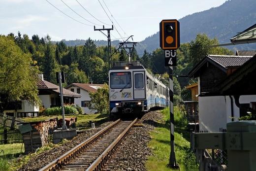 Germany Bavaria Garmisch-Partenkirchen Grainau decorated bavarian buildings Zugspits Bahn mountain train Alps : Stock Photo