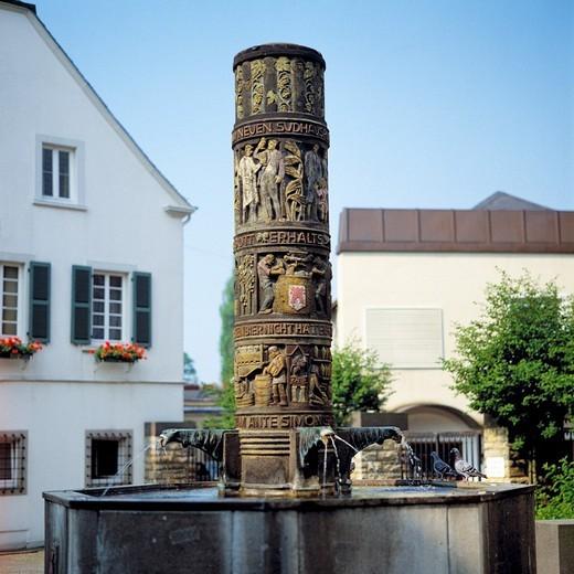 Germany, Bitburg, Bitburger Gutland, South Eifel, Eifel, Rhineland, Rhineland-Palatinate, beer fountain by sculptor professor Carl Burger, pillar, column, stele : Stock Photo