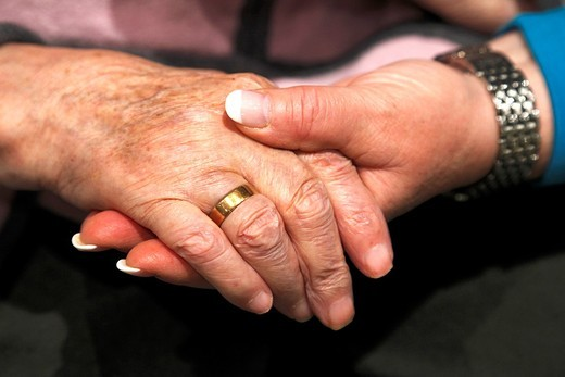 people, old age, retirement home, Altenzentrum der St  Clemens Hospitale in Sterkrade, a nurse holds the hand of an older woman, close-up, Waltraut, Elke, D-Oberhausen, Ruhr area, Lower Rhine, North Rhine-Westphalia, NRW, D-Oberhausen-Sterkrade : Stock Photo
