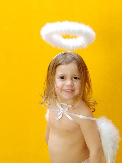 Child with angel wings and halo : Stock Photo