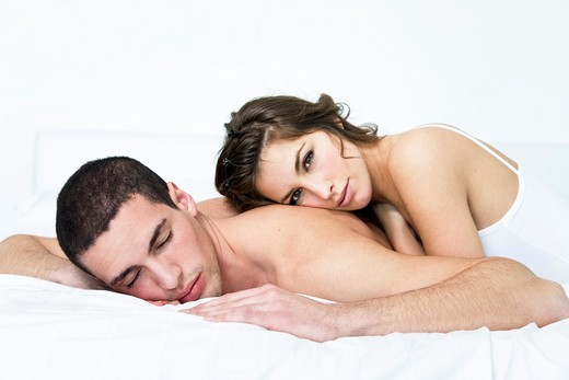 Portrait of a couple laying down in bed : Stock Photo