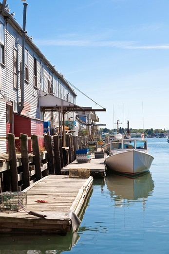 Back side of the Harbor Fish Market on the wharf in the Old Port district of Portland, Maine : Stock Photo
