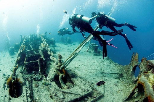 Divers at a shipwreck at Ras Mohammed National Park, Red Sea, Sinai, Egypt, : Stock Photo
