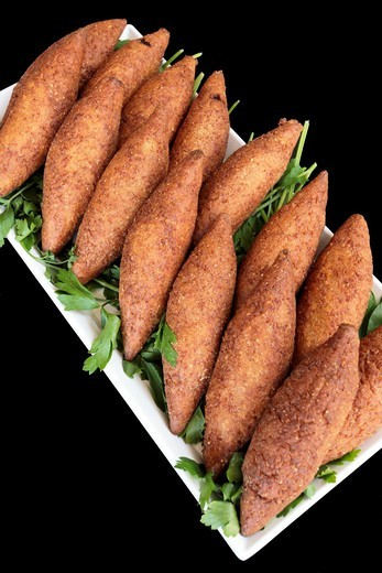 Stock Photo: 1566-600483 A serving of Kibbeh Also kubbeh  Kibbeh is meat and spices wrapped in bulgur and deep fried