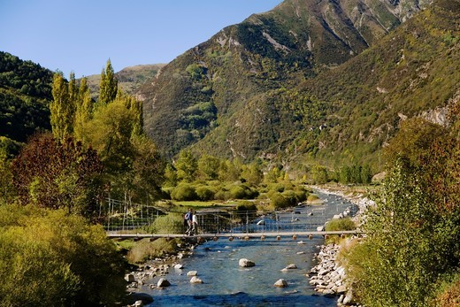Hiking. Bridge  Hiking  Camí de l´Aigua  Hiking Barruera. Boi-Taull Valley, Alta Ribagorça Region, Peripheric area, Aigüestortes i Estany de Sant Maurici National Park, Lleida province, Catalonia, Spain. : Stock Photo