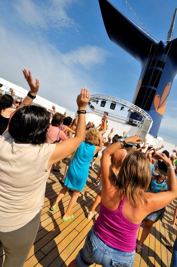 Women dancing on the deck of a cruise ship : Stock Photo