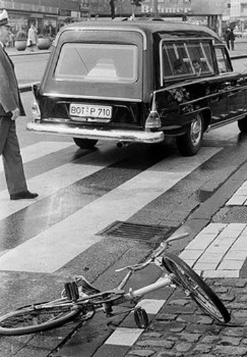Seventies, black and white photo, traffic, deadly road accident, child had been killed, childs bicycle lies near a cebra crossing, policeman, hearse, D_Bottrop, Ruhr area, North Rhine_Westphalia : Stock Photo
