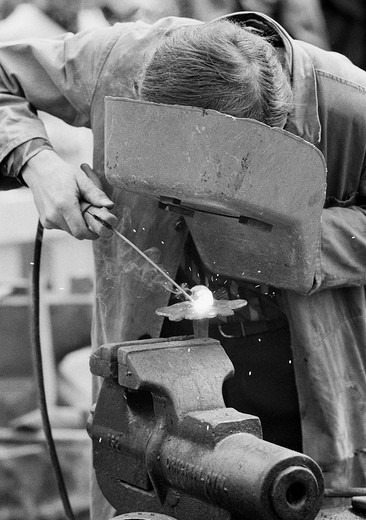 Stock Photo: 1566-609030 Seventies, black and white photo, handicraft, street party, funfair, Flachs Market in Krefeld, metalsmith forging with protective mask, welding work, D_Krefeld, D_Krefeld_Linn, Rhine, Lower Rhine, North Rhine_Westphalia