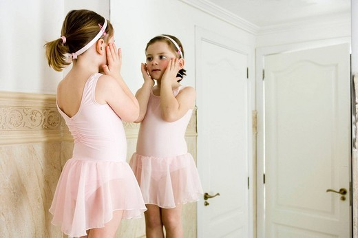 Little girl in front of the mirror : Stock Photo
