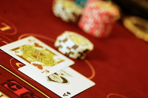 ACE (of spades) and Jack (of hearts) cards paired with poker chips on poker table, Casino : Stock Photo