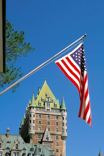 View of the Chateau Frontenac framed by the American flag, Quebec City, Quebec, Canada : Stock Photo