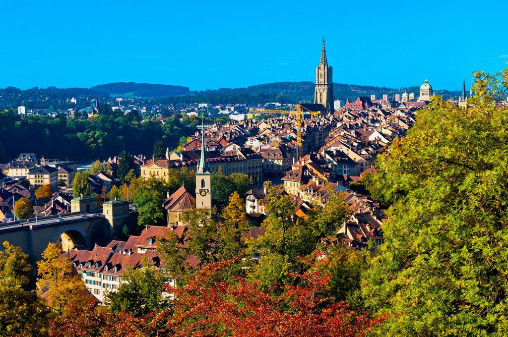 Stock Photo: 1566-618867 Cityscape of the medieval city center of Bern with the Munster Cathedral of Bern and the Parliament Building Federal Palace of Switzerland in back, Bern, Canton Bern, Switzerland