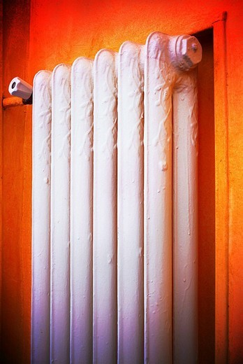 Old radiator heating system of hot water. : Stock Photo