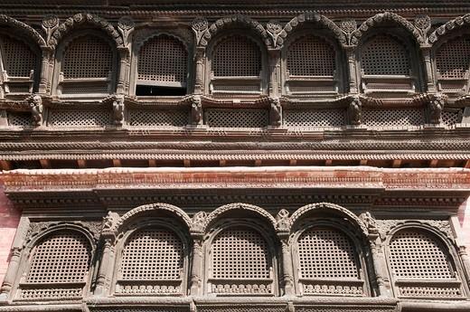 Newari style wood craftsmanship on windows at Durbar Square in Kathmandu, Nepal : Stock Photo