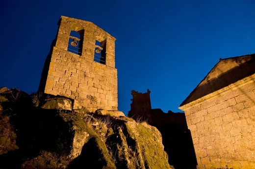 Stock Photo: 1566-623180 Night view of the San Juan Bautista Chuch wit the Trevejo Castle behind  Trevejo  Villamiel  Sierra de Gata  Caceres province  Extremadura  Spain