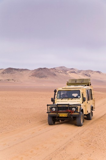 Stock Photo: 1566-625282 A landrover driving through the isolate Skeleton Coast Park