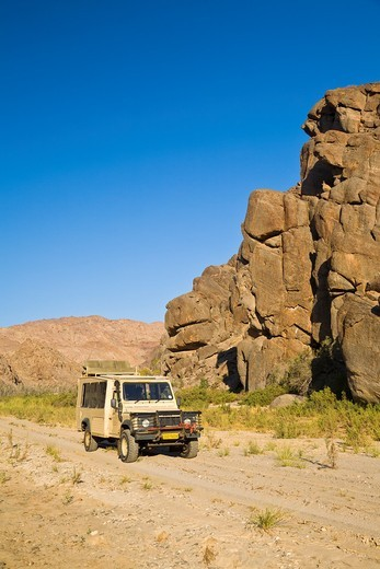 Stock Photo: 1566-625284 A landrover in the Hoarusib Riverbed Gorge