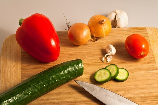 Stock Photo: 1566-625632 A chopping board full of delicious vegetables