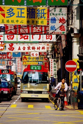Bus waiting at an intersection in Kowloon Hong Kong : Stock Photo