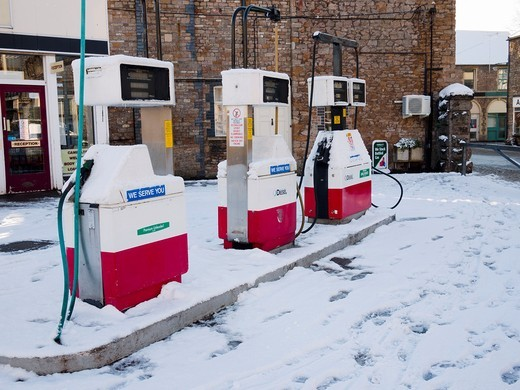 Petrol pumps on the forecourt of a village petrol station  Wrington, North Somerset, England, United Kingdom : Stock Photo