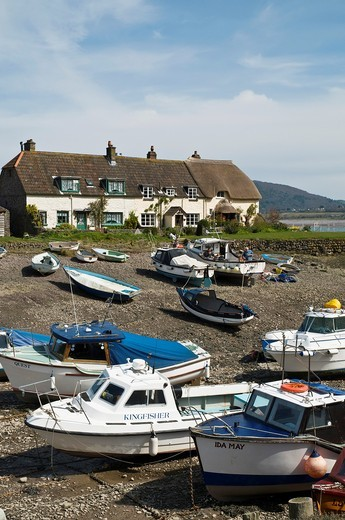 Stock Photo: 1566-630149 PORLOCK WEIR SOMERSET Beached boats Porlock Weir Harbour and thatched cottages
