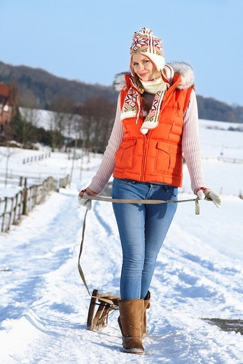 young woman in winterly landscape : Stock Photo