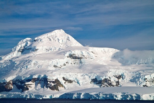 Views of Crystal Sound, south of the Antarctic Circle, Antarctica, Southern Ocean  MORE INFO This area is full of flat first year sea ice, well developed icebergs, with many open leads : Stock Photo