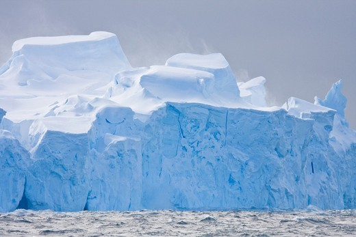 Iceberg detail in and around Crystal Sound near the Antarctic Circle on the Antarctic Peninsula during the summer months  More icebergs are being created as global warming is causing the breakup of major ice shelves and glaciers : Stock Photo